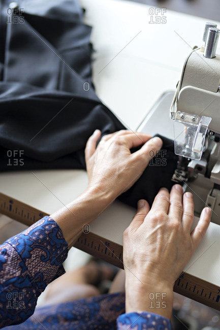 Woman sewing, close-up - Offset Collection