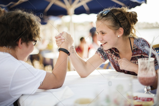 Brother and sister arm wrestling