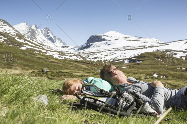 Hikers resting on meadow
