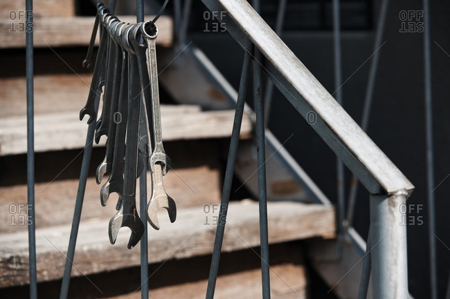 Old wrenches hanged on a banister