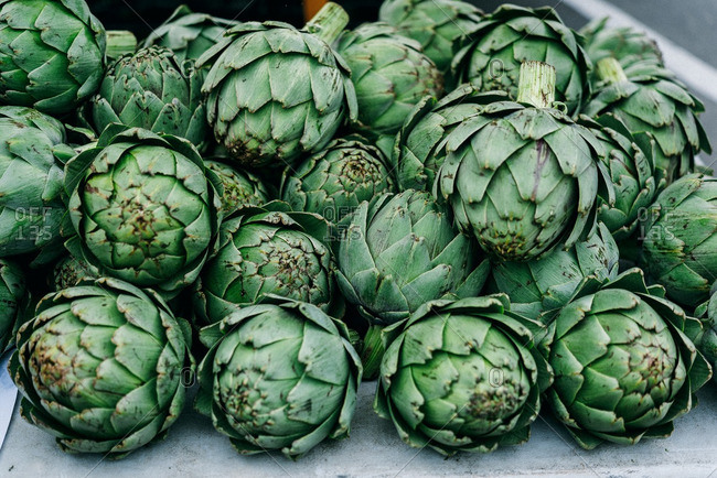 Artichokes in pile on table