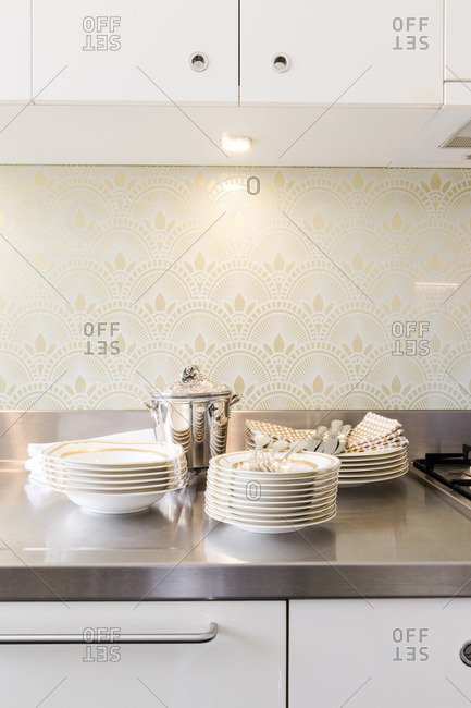 White and gold dishes on a sleek modern counter