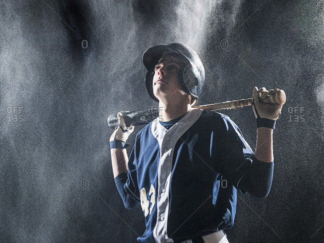 Caucasian baseball player standing in rain