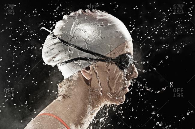 Caucasian swimmer standing in rain