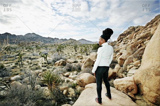 Black runner in desert landscape, Joshua Tree National Park, California, United States