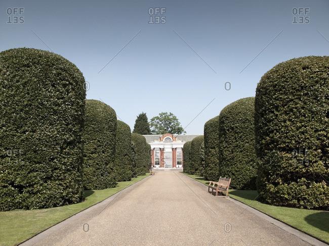 London, London, UK - April 22, 2011: Manicured hedges on ornate driveway