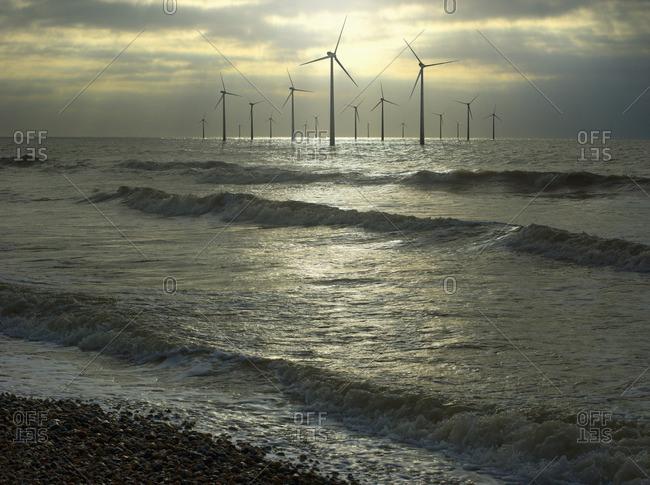 Wind turbines in ocean, Brighton, Sussex, England
