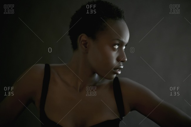 African American woman posing indoors