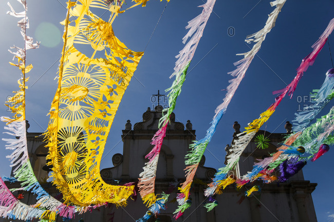Colorful streamers hanging from a church in Antigua, Guatemala
