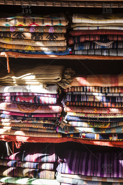Stacks of folded woven textiles for sale in Antigua, Guatemala