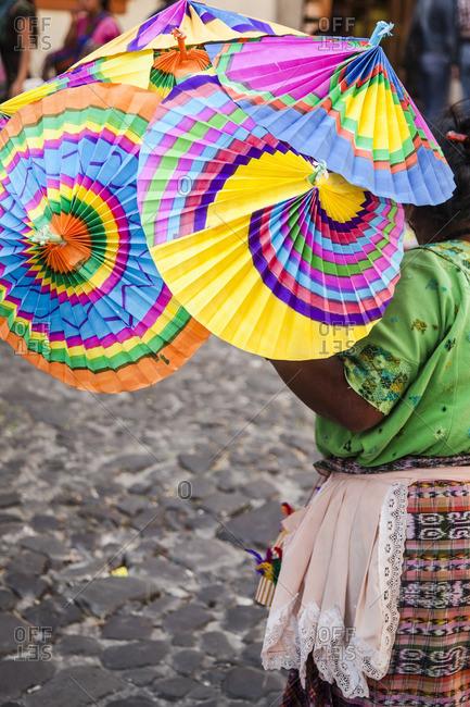 Parasol vendor on the streets in Antigua, Guatemala
