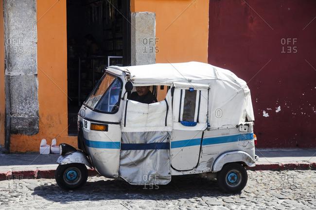 Antigua, Guatemala - February 5, 2016: Three wheel taxi on the street