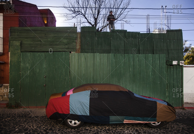 Antigua, Guatemala - February 8, 2016: Car covered in tarp parked on the street