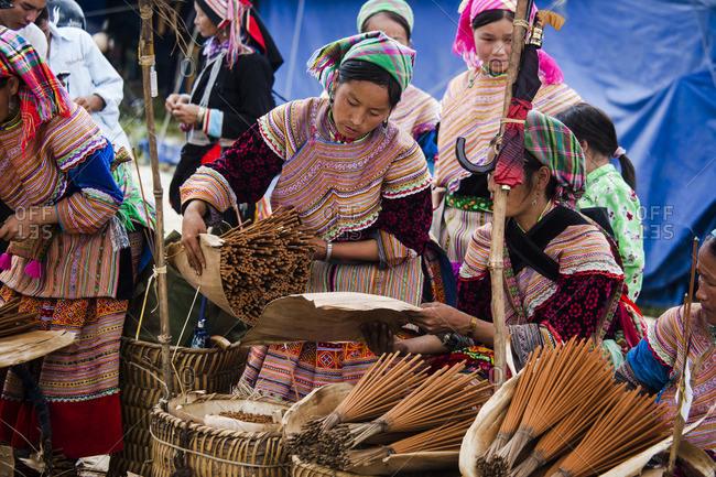Bac Ha, Vietnam - September 28, 2008: Women selling incense at the Bac Ha market
