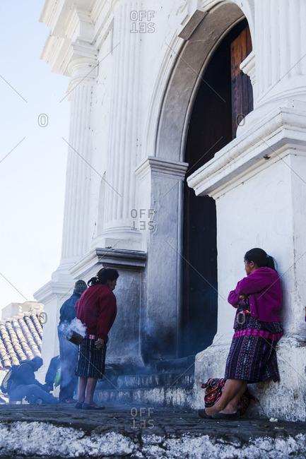 Chichicastenango, Guatemala - February 11, 2016: Woman performing ritual on the steps to the Iglesia de Santo Tomas