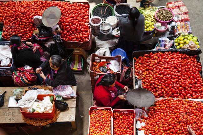 Chichicastenango, Guatemala - February 11, 2016: Overhead view of women selling goods at the market in Chichicastenango