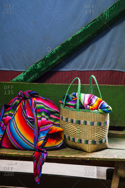 Colorful cloth and basket on a bench in Chichicastenango, Guatemala
