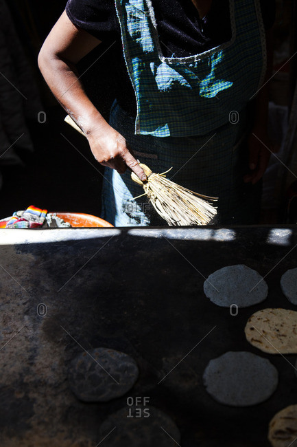 Person sweeping with small broom in Chichicastenango, Guatemala