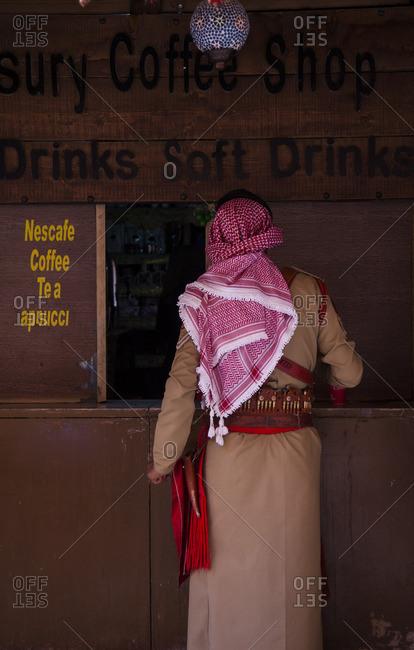 Bedouin officer ordering at a coffee shop, Petra, Jordan