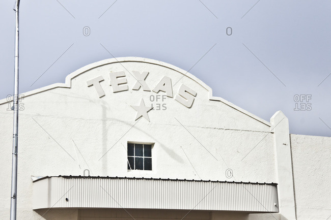 White building with a star and Texas on the exterior, Marfa, Texas