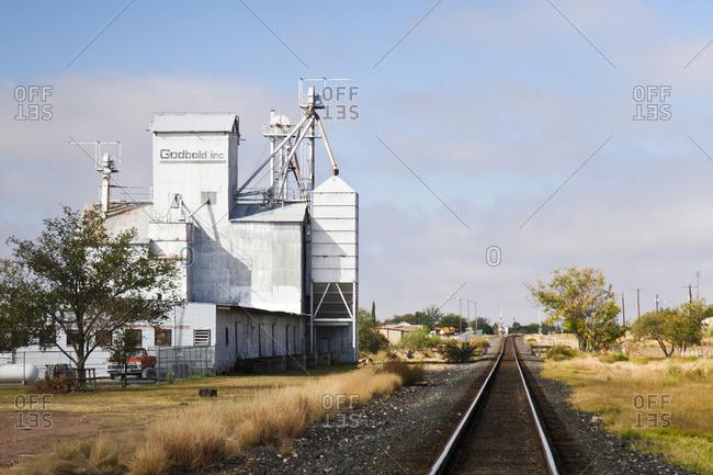 Marfa, Texas - October 23, 2014: Cattle feed mill beside train tracks in Marfa, Texas