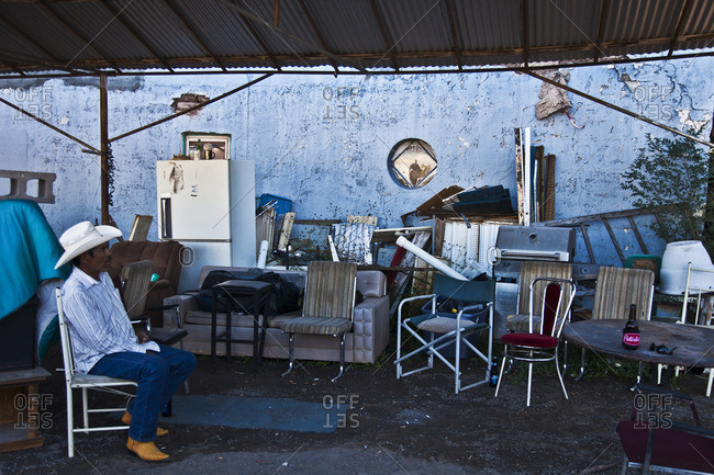 Marfa, Texas - October 24, 2014: Man relaxing in a chair outdoors in Marfa, Texas