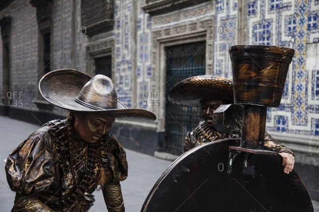 Mexico City, Mexico - January 30, 2016: Street performers dressed in metallic outfits in Mexico city