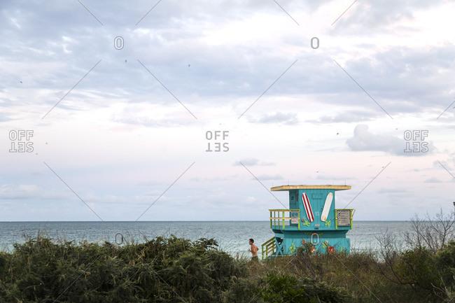 Miami Beach, Florida - December 7, 2012: Man running along beach