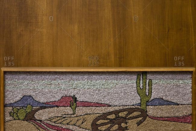Piece of art with desert landscape