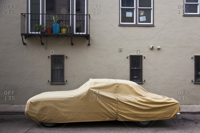 Car parked on the street and covered with a tarp, San Francisco, California