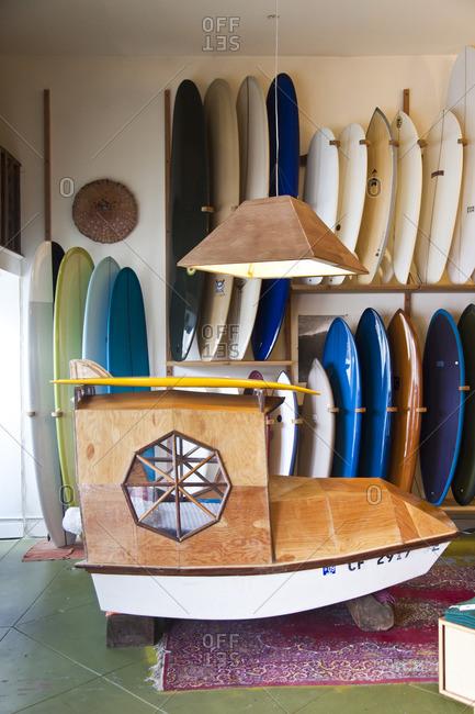 Decorative boat inside a surf shop in San Francisco, California