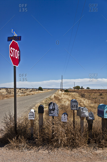 Santa Fe, New Mexico - October 27, 2014: Mail boxes by a stop sign in New Mexico