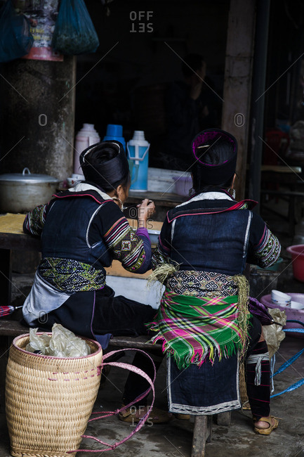 Rear view of women eating together in Sa Pa, Vietnam