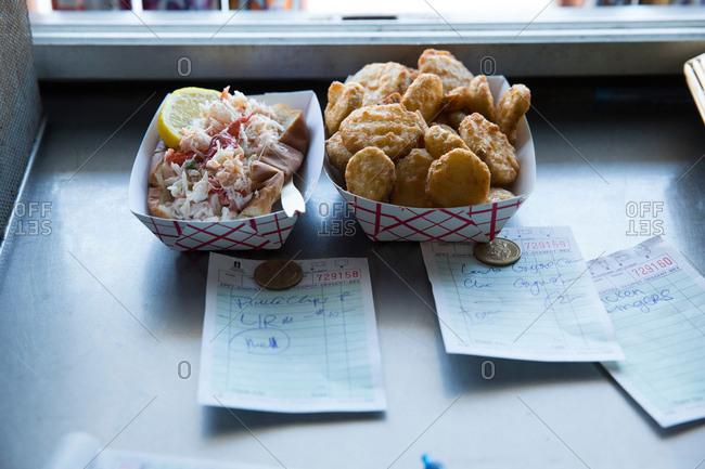 Prepared food by hatch in fast food trailer