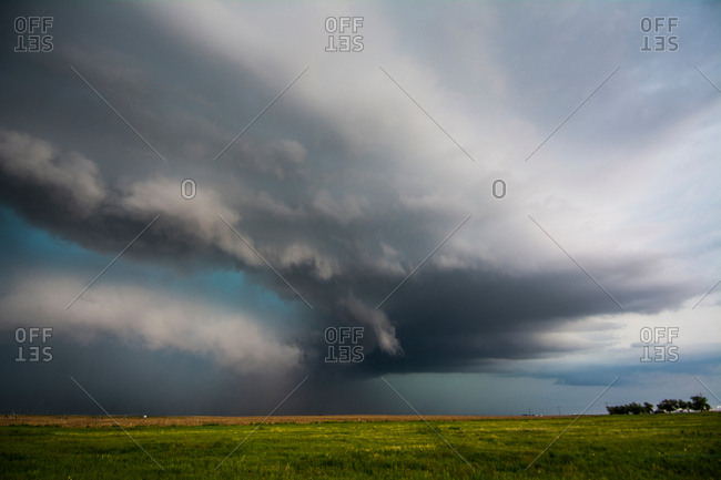 A supercell storm assumes a green color after producing tornadoes near Felt, Oklahoma
