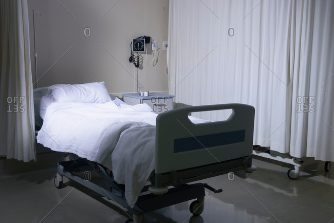 Empty unmade hospital bed in hospital ward
