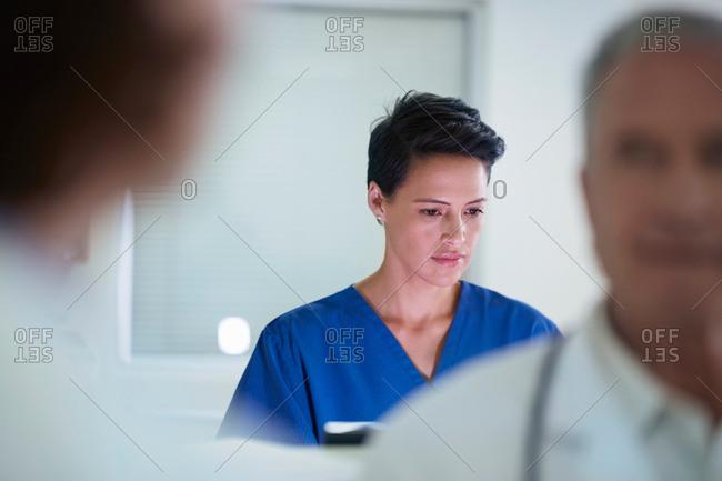 Nurse busy at nurses station in hospital