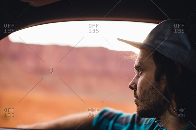 Young man gazing through car window, Monument Valley, Arizona, USA