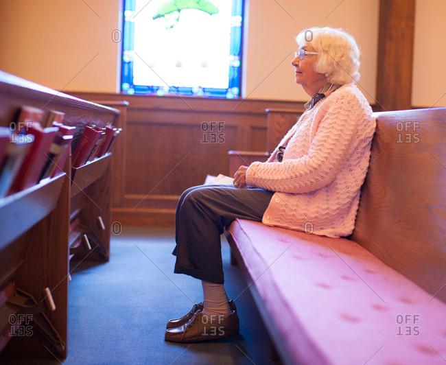Senior woman sitting in chapel