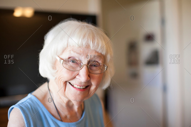 Portrait of senior woman, indoors, smiling