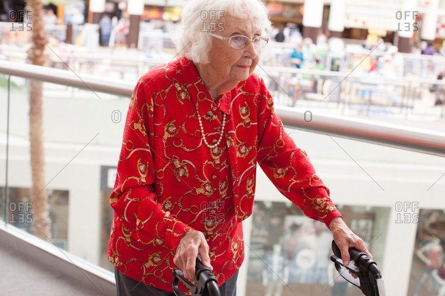 Senior woman walking with walking frame