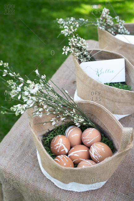 Flowers and eggs in canvas bags