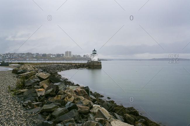 Lighthouse along rock strewn coast
