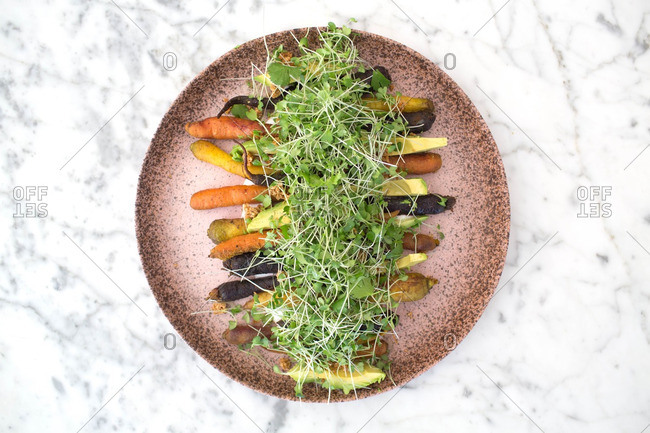 Sprouts on carrots and avocado