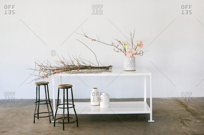 Floral branches on table with vases