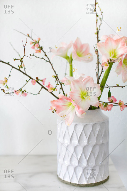A vase with floral branches