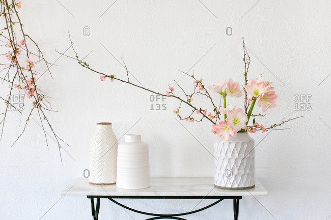 Table with vases and floral branches