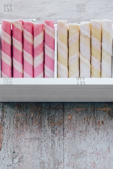 Yellow and pink rolled wafers