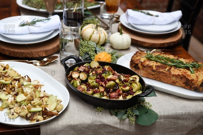 Vegetable side dishes and bread on a rustic table