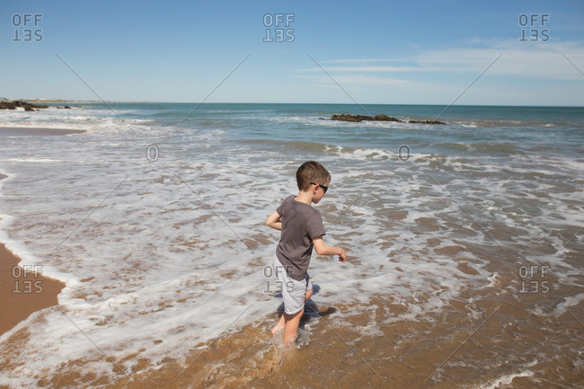 Boy in the surf in ocean